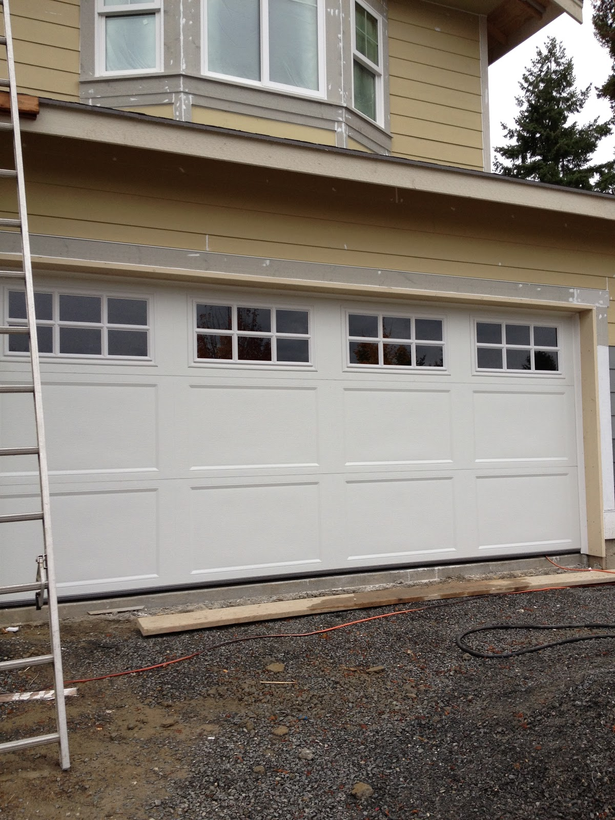 Building our dream home from the ground up progress 2 car garage doors