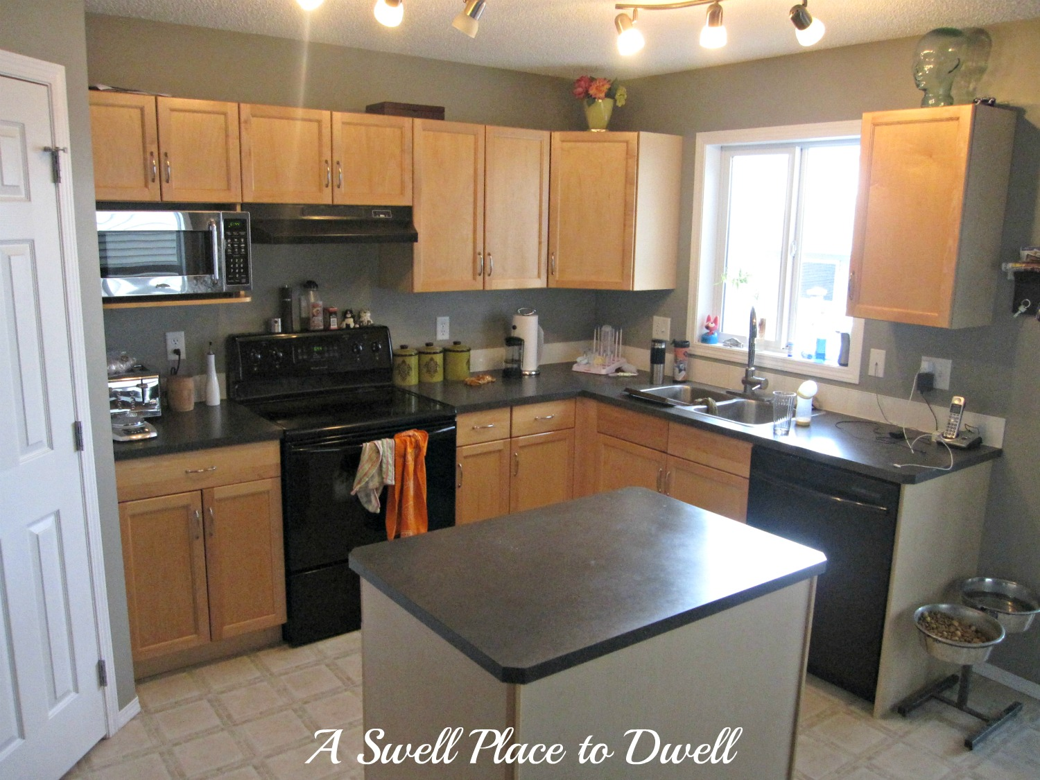 A swell place to dwell how to paint kitchen cabinets how to paint kitchen cabinets kitchenmakeover budget paint dailygadgetfo Images
