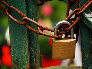 A rusty chain with a padlock.