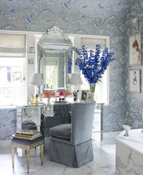 The vanity unit is set in a beautifully designed bathroom. The mix of marbled walls & floors with wallpaper is breath taking. its so elegantly put together.