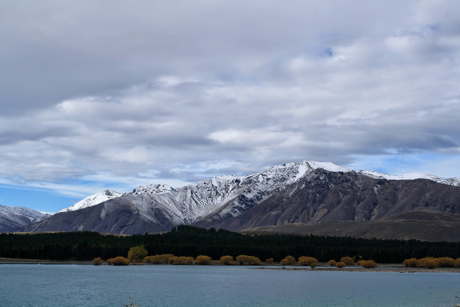 Lake Tekapo, with some mountains.