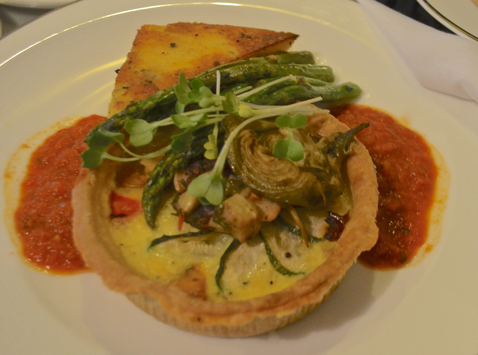 Tart baked in Rosemary Olive Crust with a Roasted Tomato Herb Sauce