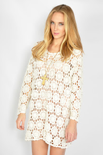 Vintage cream colored cotton crocheted mini dress with long sleeves.