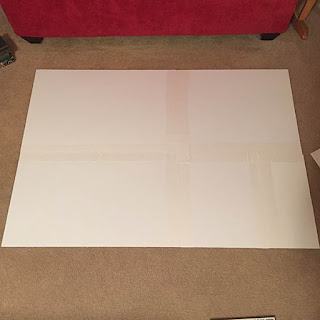 White foam core board glued to the back of a large puzzle