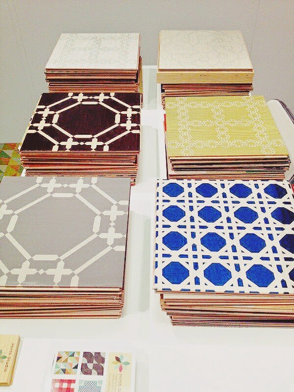 COCOCOZY for Mirth Studio painted wood floor tiles on display at High Point Market