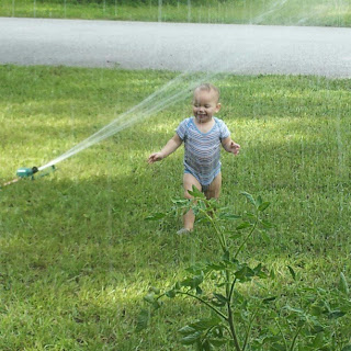 Wordless Wednesday picture of our toddler baby playing in the water sprinkler for the first time in his life