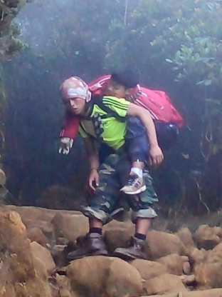 A photo of a sprightly mountain guide carrying an injured boy on his back has been making its rounds on social media. But Mhd Rizuan Kauhinin, 25, said all that mattered was to bring the boy to safety.