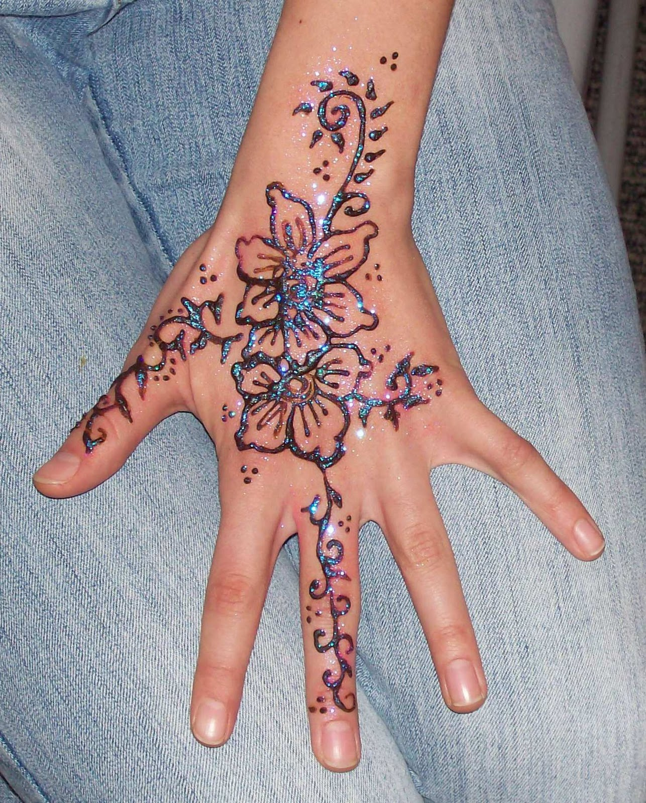 Flower henna designs design for Flower tattoos on hand