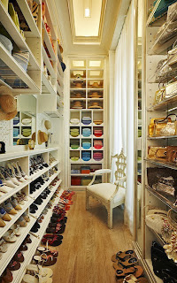 Well organized, massive closet with floor to ceiling accessories