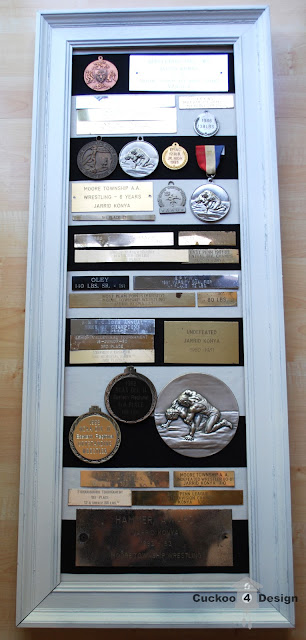 old white frame with old trophies and medallions