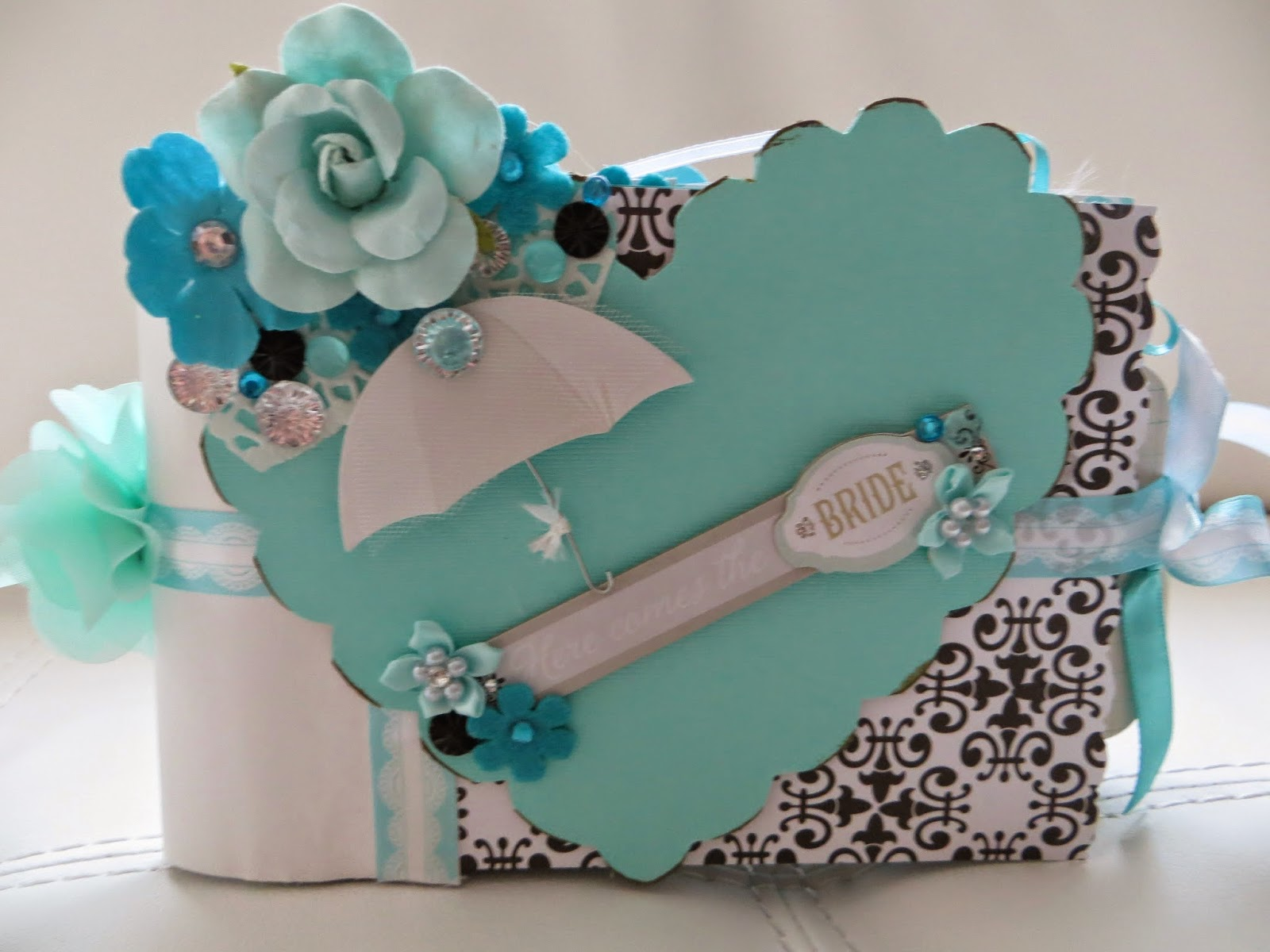 this chipboard heart and paper bag scrapbook album was made especially for a bride to be the main colors are white black tiffany blue along with some