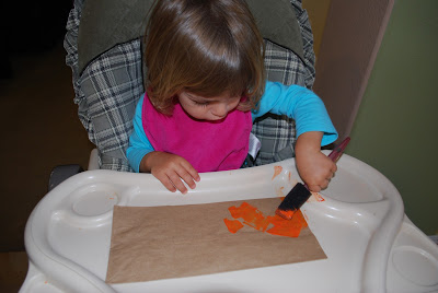 kids making Halloween crafts