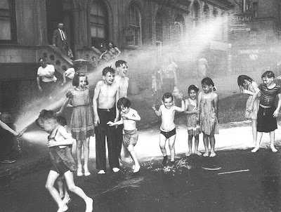photograph o kids in the summer cooling off with a fire hydrant