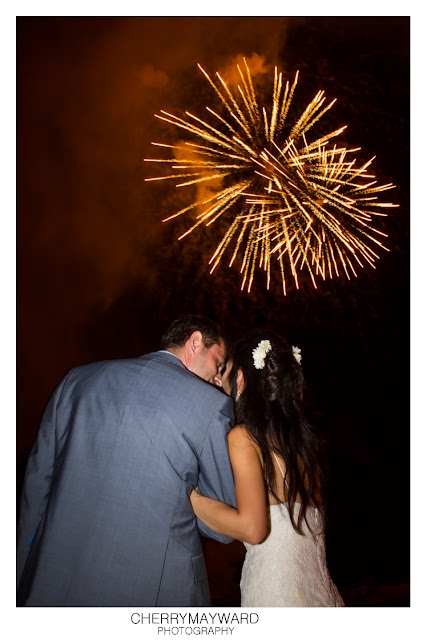 Married couple watching fireworks.