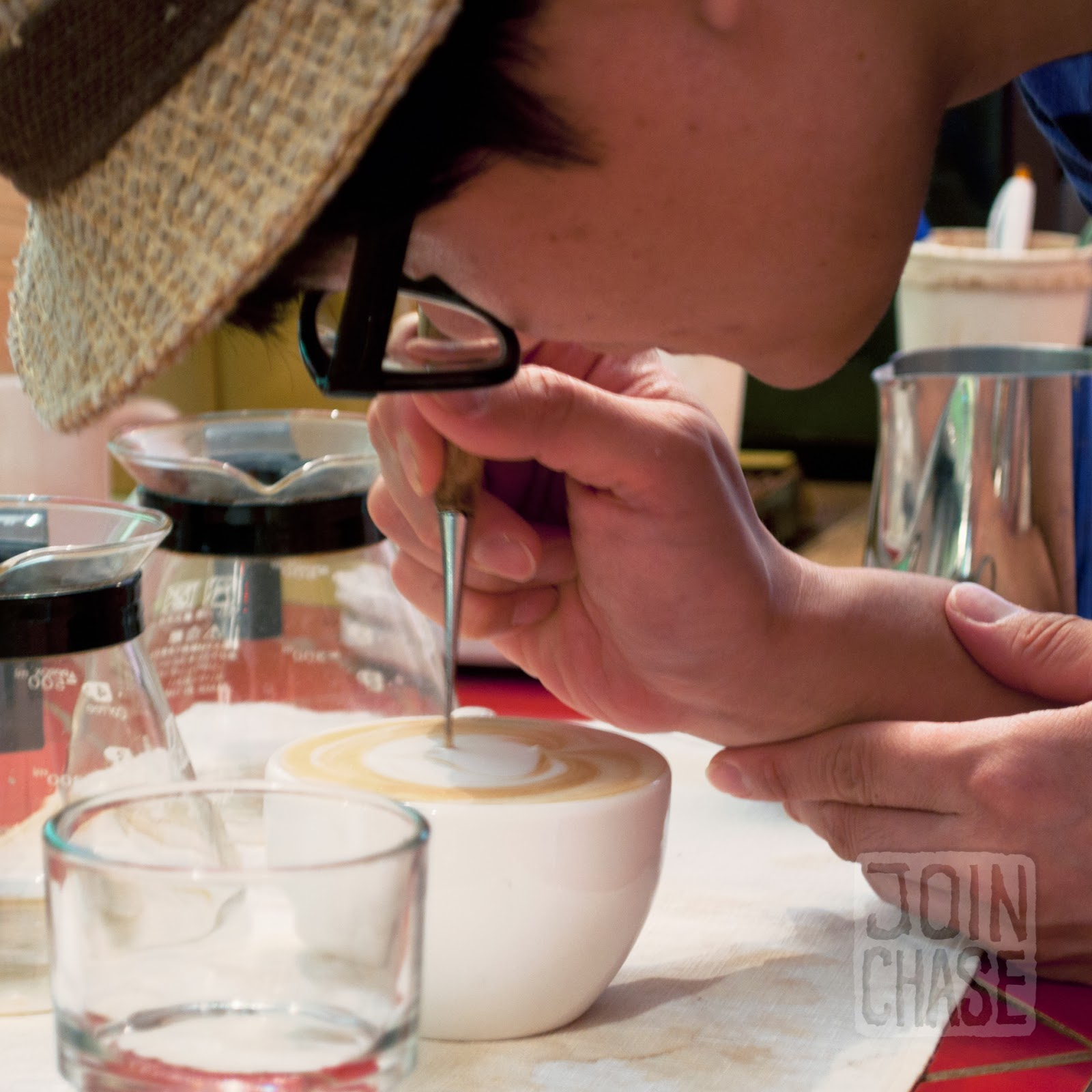 A Korean man making latte art in Ochang, South Korea.