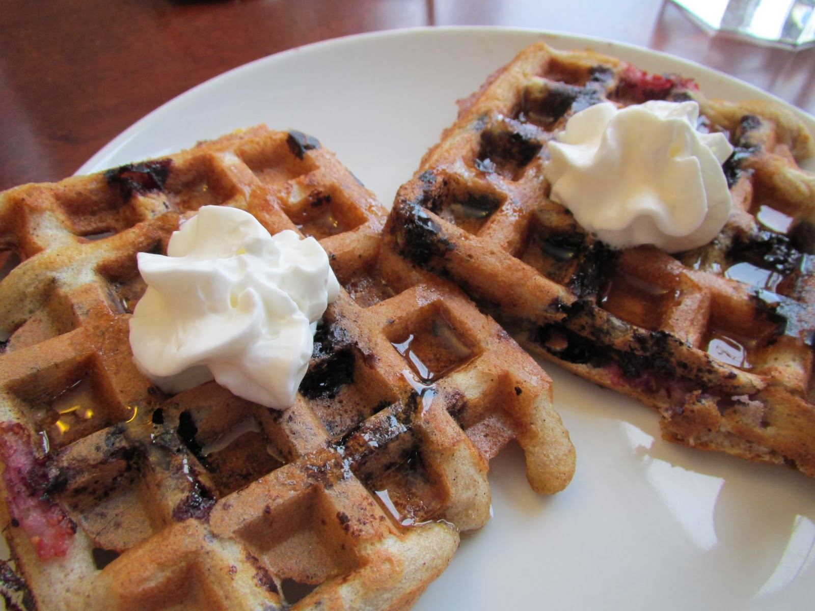 Lemon-Blueberry Sourdough Waffles topped with fresh maple syrup and ...