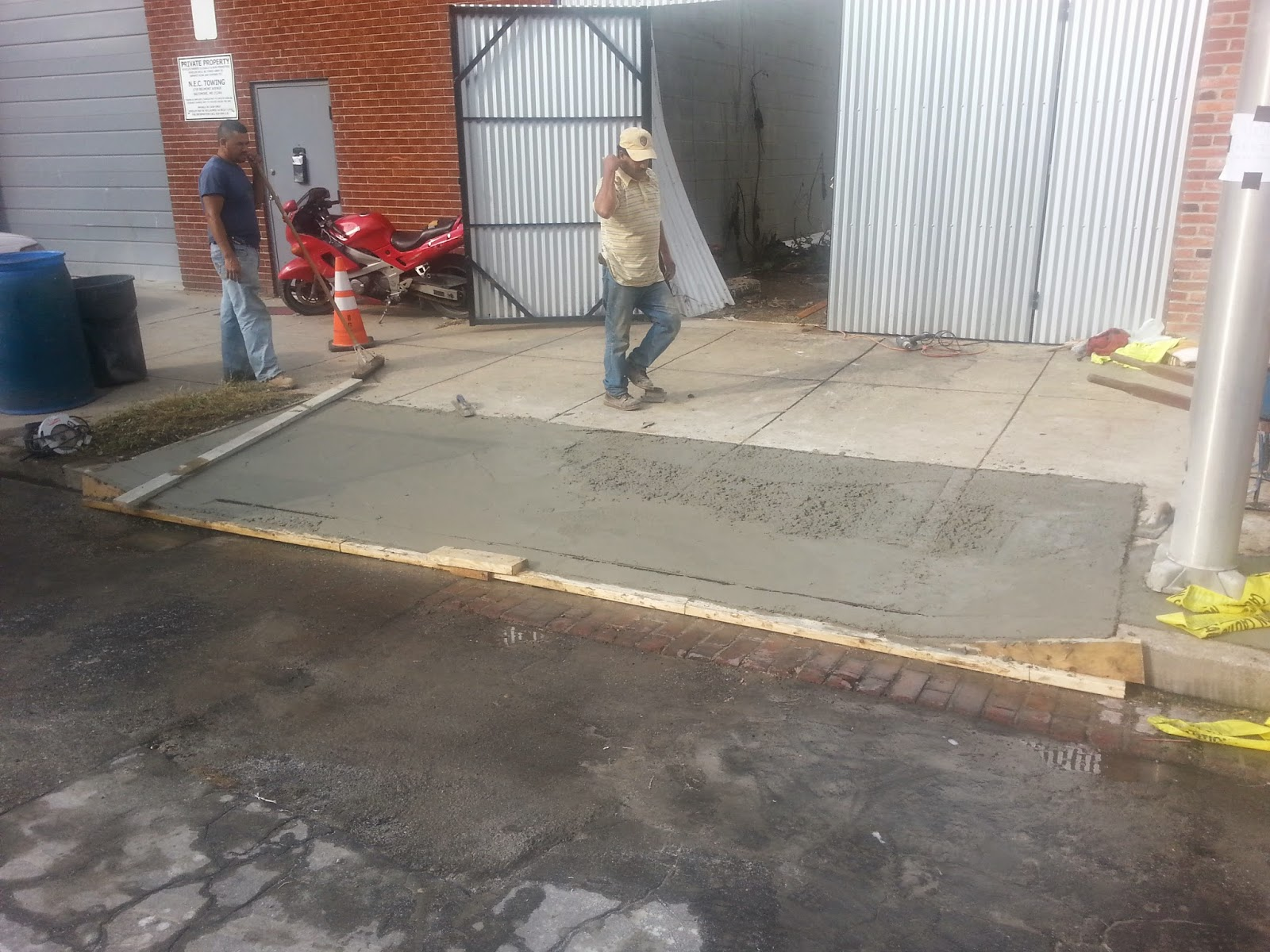 Custom stoneworks design inc concrete pour in for Pouring concrete driveway