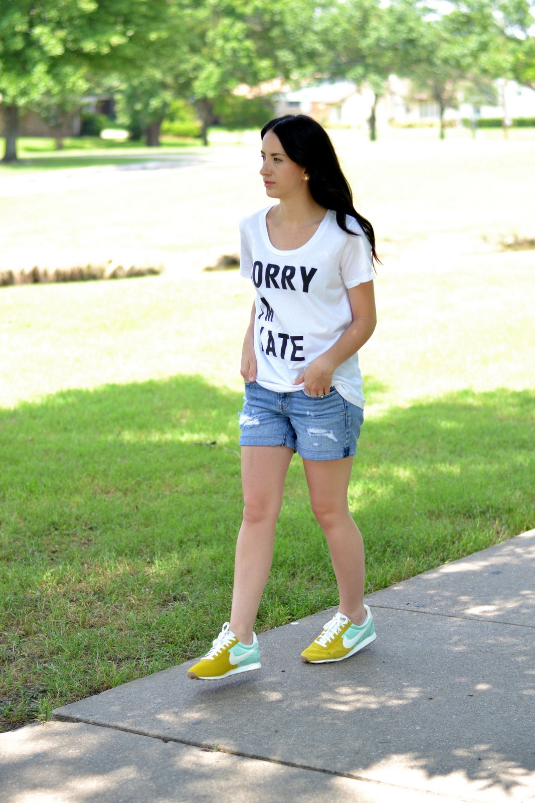 Casual Summer Tee, Nikes and Distressed Shorts