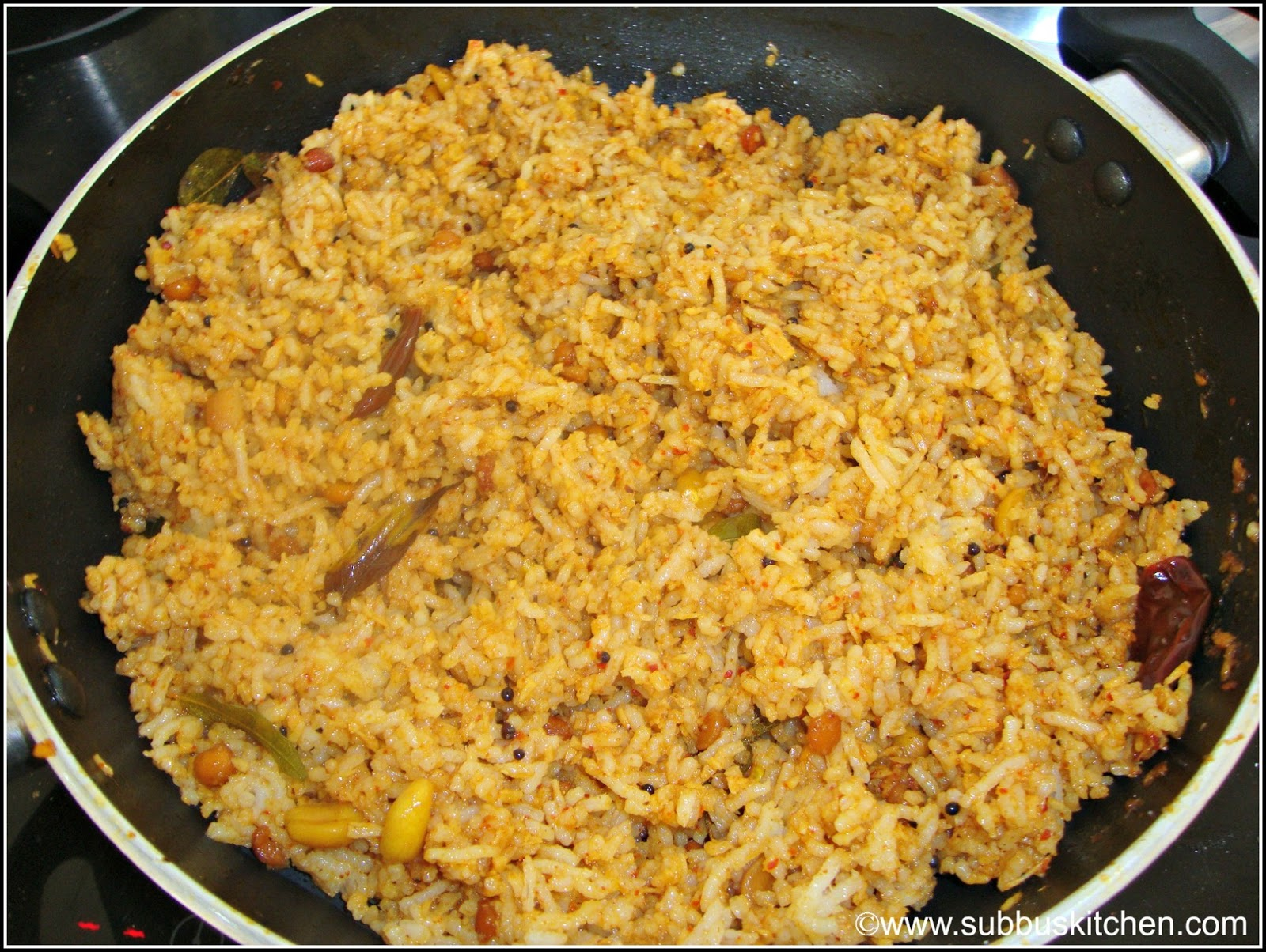 Serve the yummy and spicy tamarind rice with appalam or any pappad