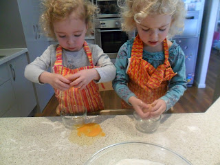 Cracking eggs into a dish for rainbow cake.