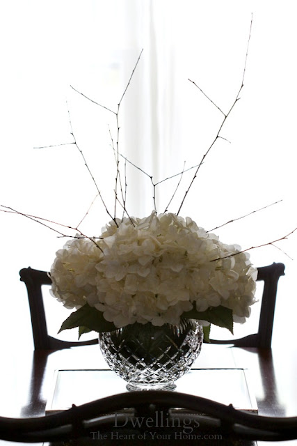 Hydrangea and twig dining room centerpiece.