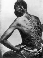Black man with scars from whipping