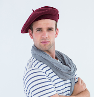 young man wearing a beret and trying to sport a French attitude
