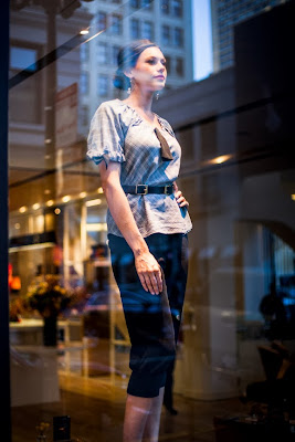Our gorgeous model in the Nespresso window.