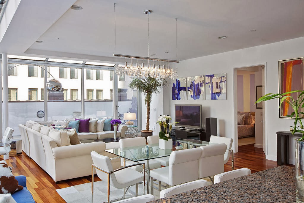 canvass white interior is styled up by sparks of purple inside this modern living area