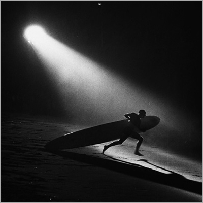 http://kvetchlandia.tumblr.com/post/135168060248/ralph-crane-night-surfing-manhattan-beach-ca