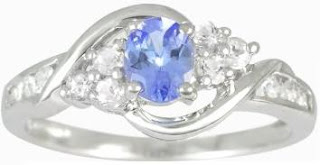 10K White Gold Oval Tanzanite and Round White Topaz Ring
