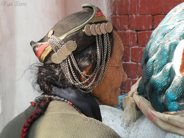 Eastern Sherpa woman wearing a hat decorated with coins
