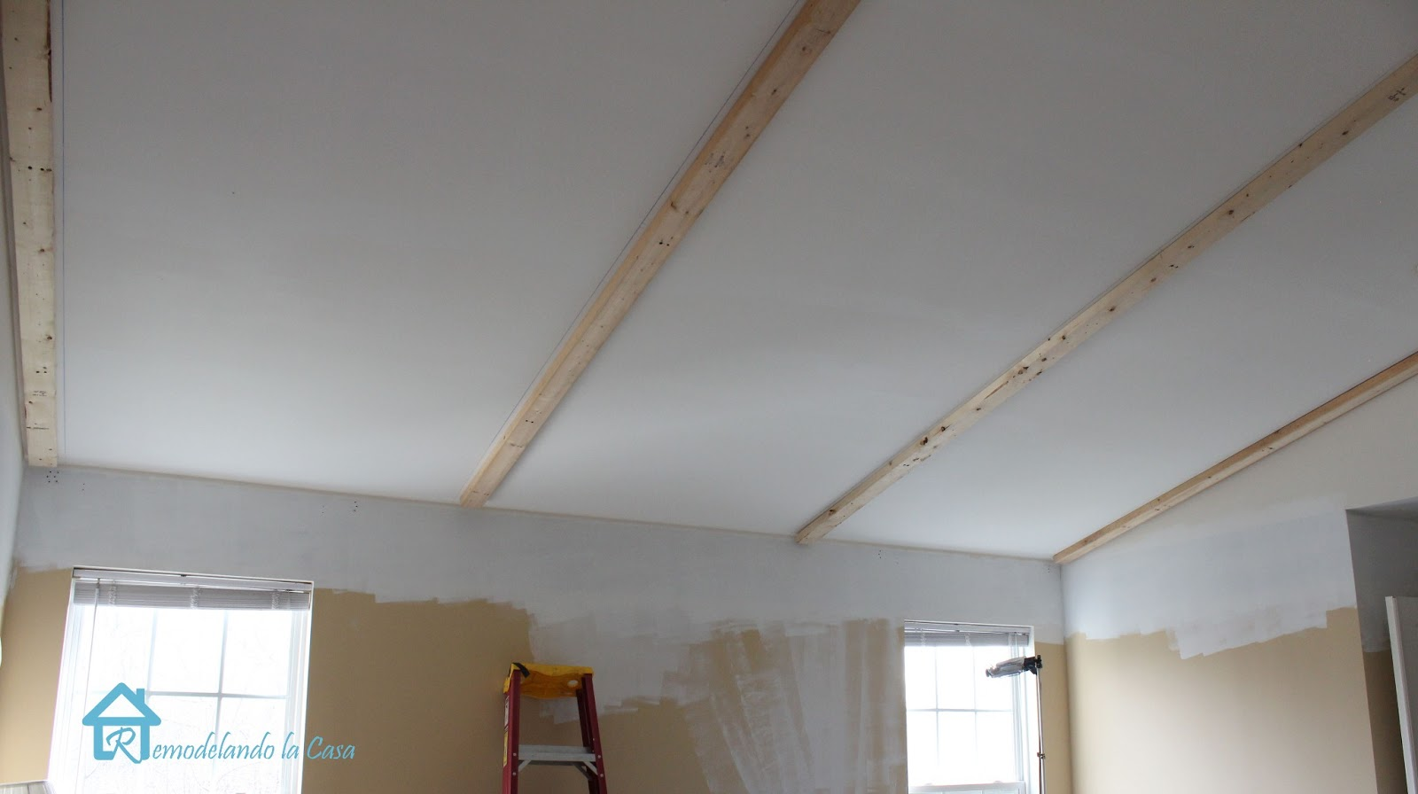 Installing faux wooden beams the reveal remodelando la for Fake wood beams for ceiling