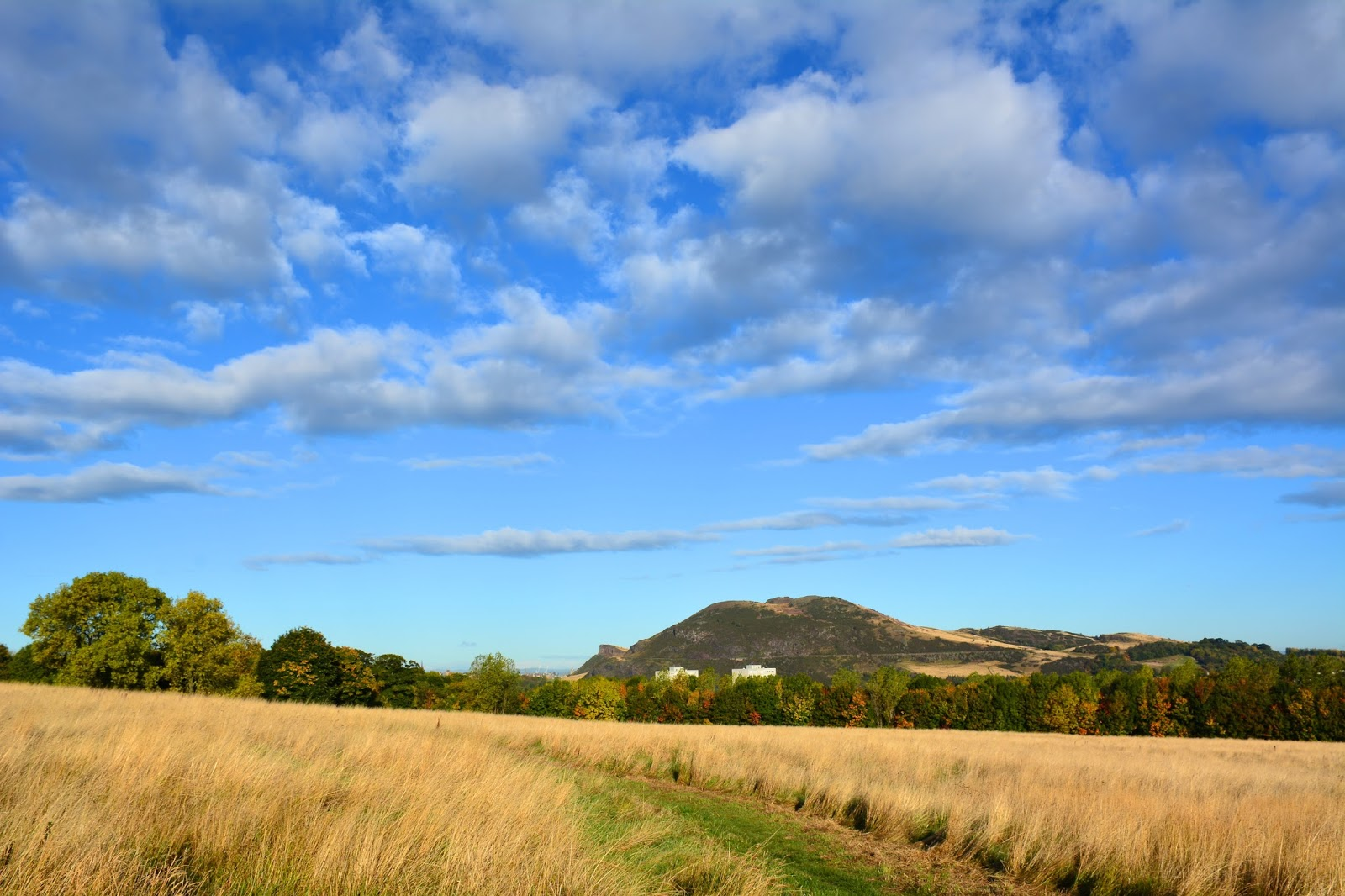 blue skies over Arthur's Seat