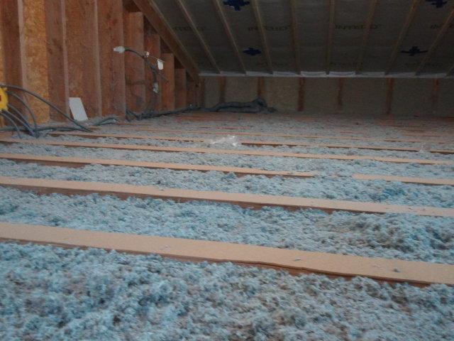 Notre maison ossature bois isolation paille isolation for Isolation plancher bois etage