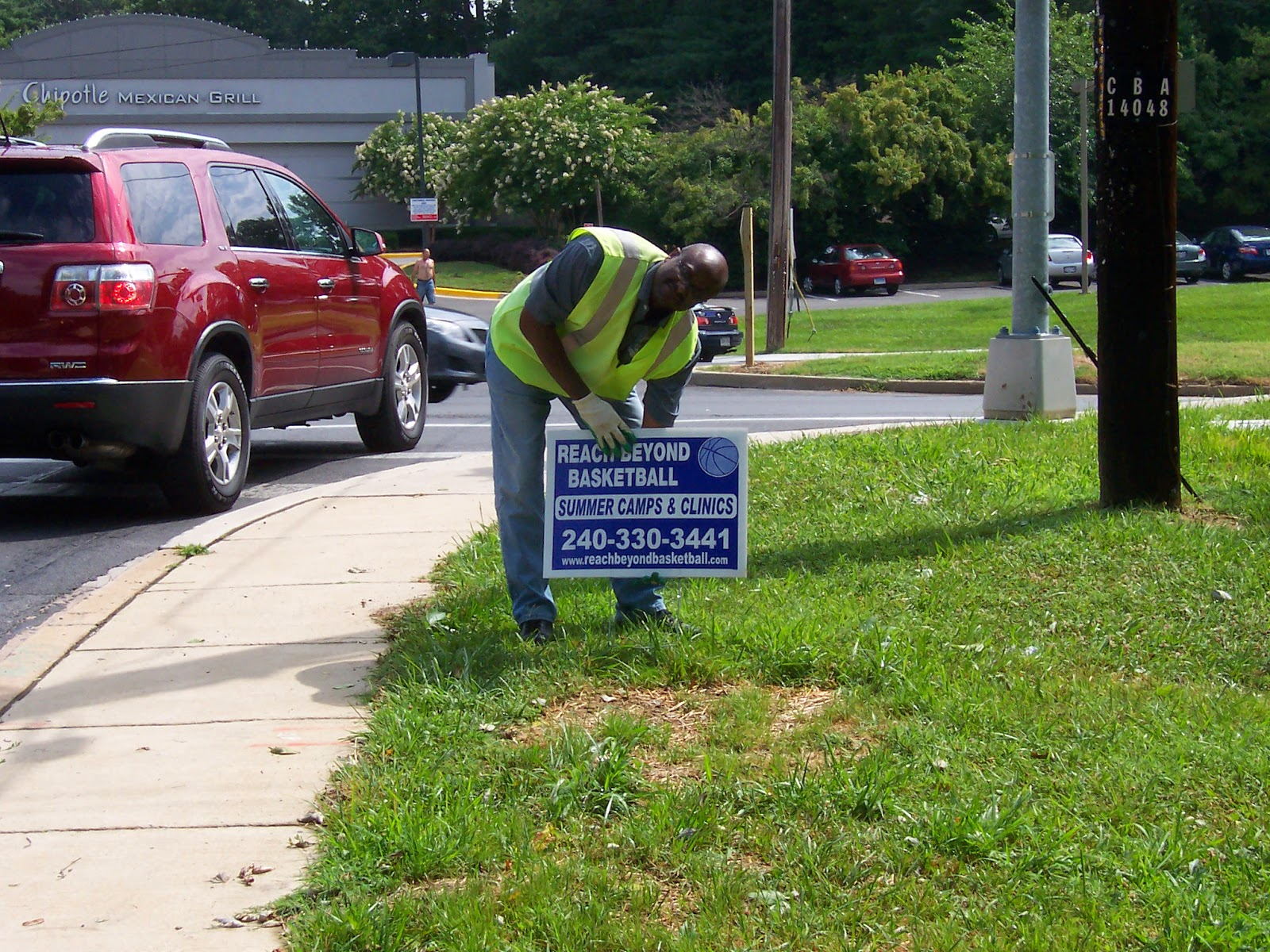 Sign Sweep team member removes a sign.