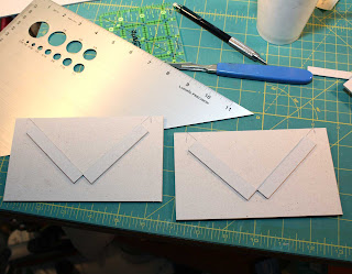 Join the two main cradle pieces by gluing a book cloth strip down the center ...