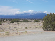 . nearby mountains, showing a little more snow on the peaks than there had .