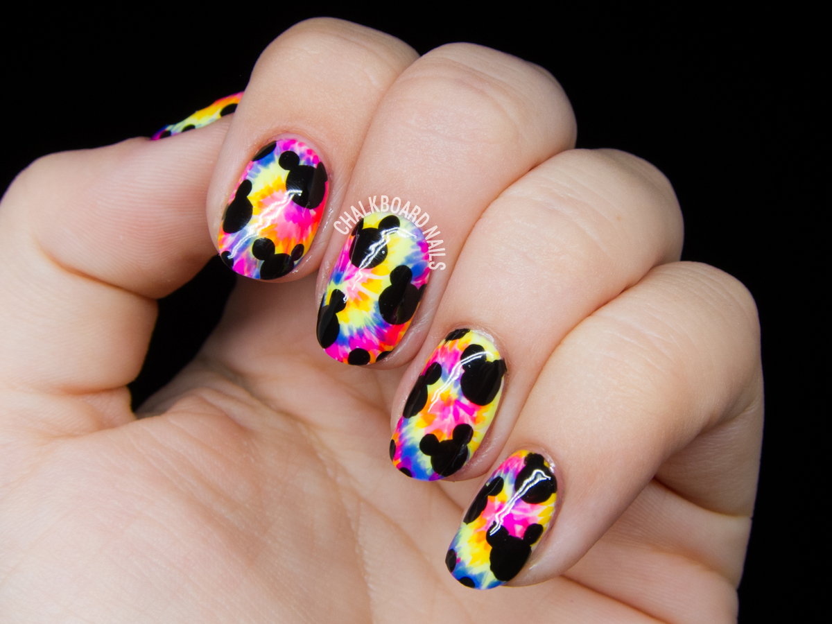 Trippy Mickeys nail art by @chalkboardnails