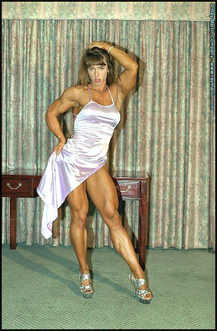 Denise Hoshor Showing Off Her Muscular Legs In A Dress And Heels