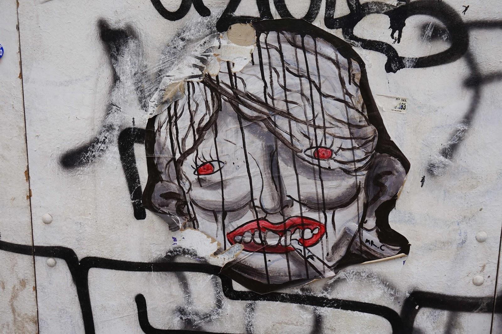 creepy women smoking, barcelona street art