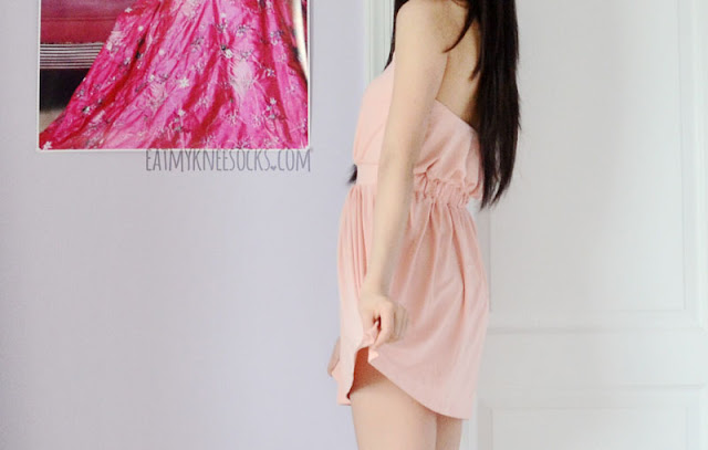 WalkTrendy's pink halter dress is great for summer, with a cute ruched waist and unique cutouts.