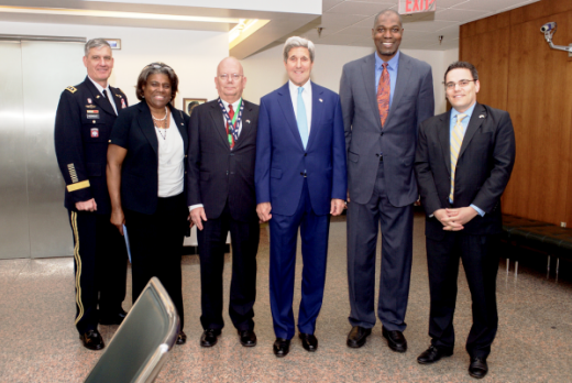 'The Dream'! Hakeem Olajuwon Accompanies John Kerry To Buhari's Inauguration