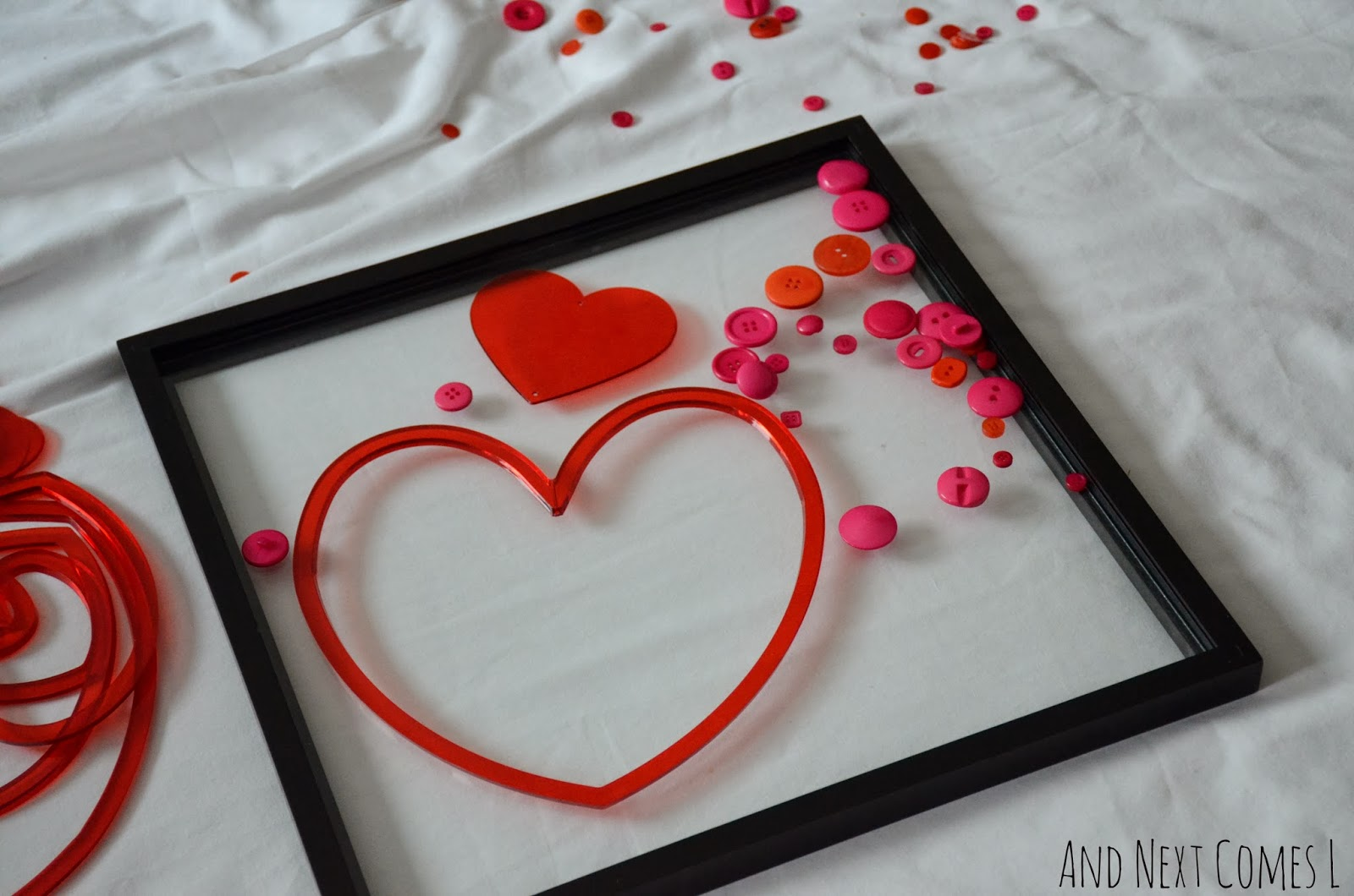 A Valentine's Day invitation to play with buttons, hearts, and a picture frame from And Next Comes L