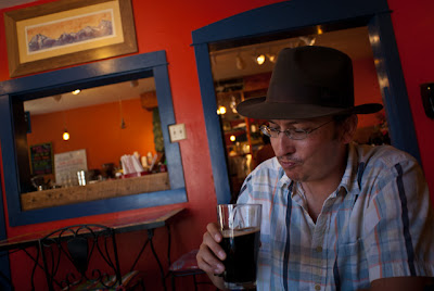 Jeremy Wade Shockley enjoys a cold beer at the Avalanche Coffee House and Bakery in Silverton, CO.