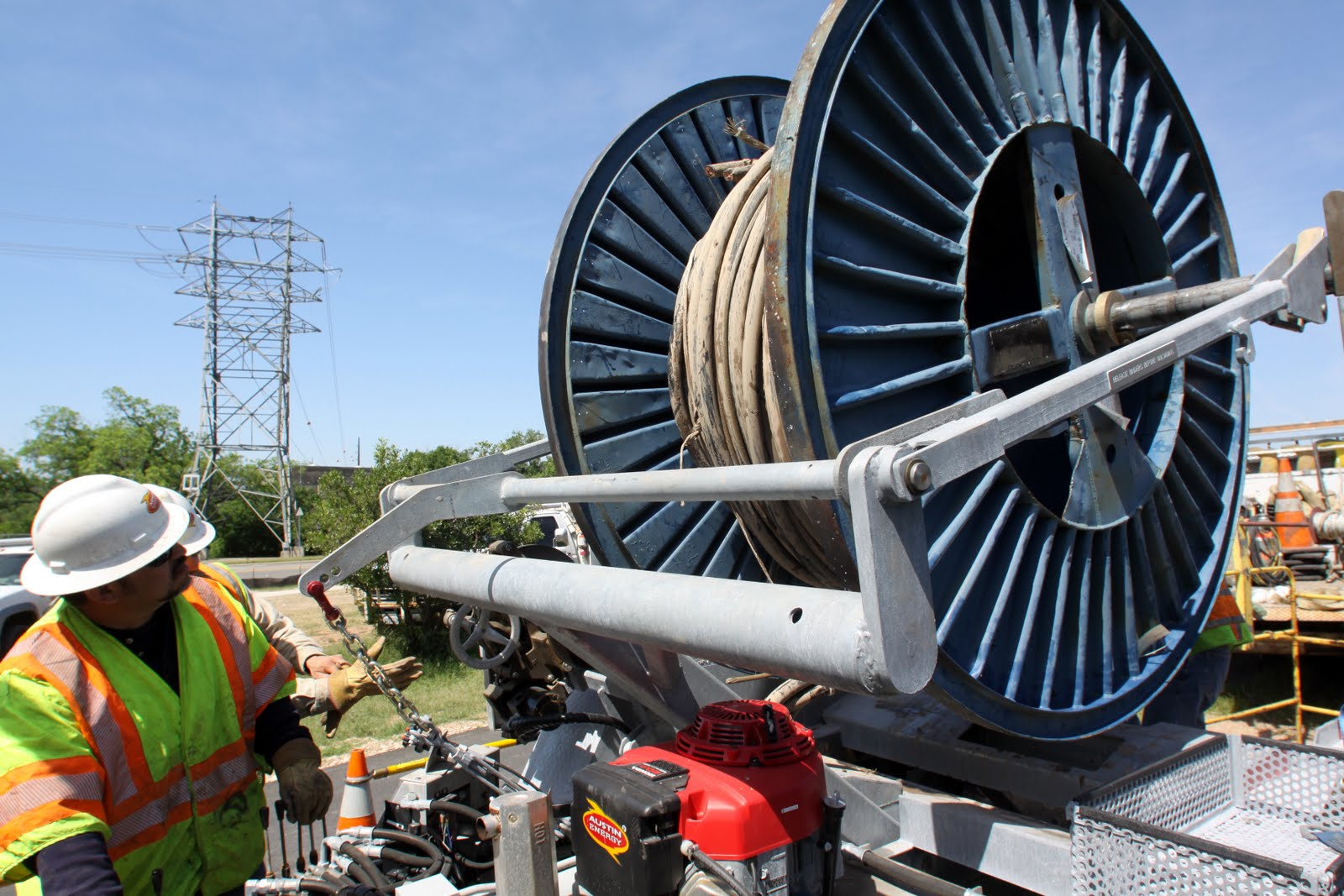 Austin energy linemen use reels to install new cable as well as take out old cable that is being replaced the reels can each hold 1 200 linear feet of