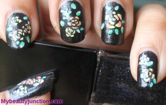 Floral nail art stickers on Givenchy Noir Celeste polish