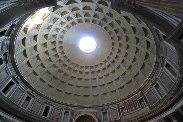 "The beautiful architecture of the Pantheon dome with an opening hole to the sky called ""Oculus"" in Rome, Italy"