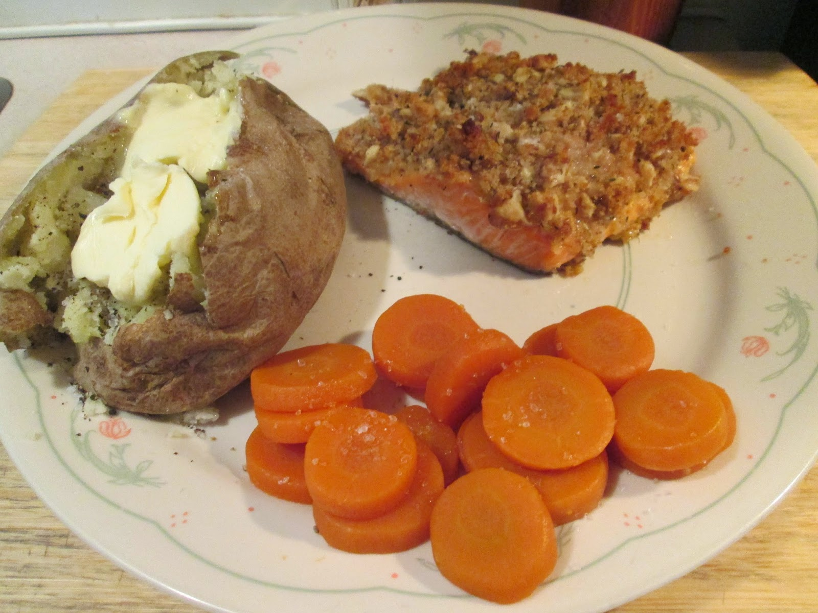 walnut-crusted salmon w/ baked potato and sliced carrots