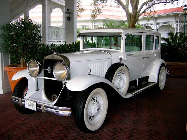 Old fashioned Victorian white car outside Grand Floridian, Disney World, Florida